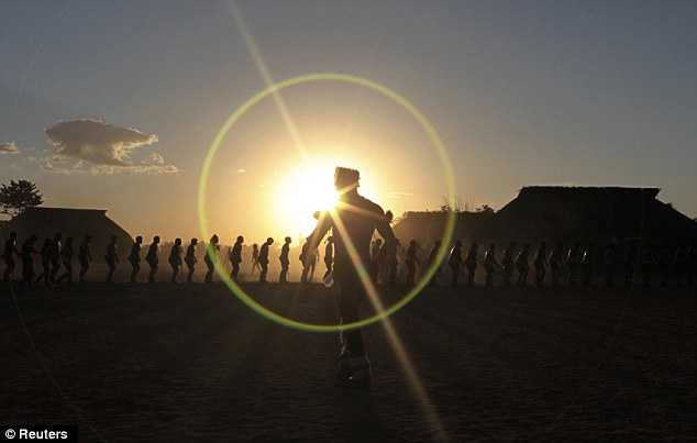 Commitment: The men of the Yawalapiti tribe continued to dance as the sun went down