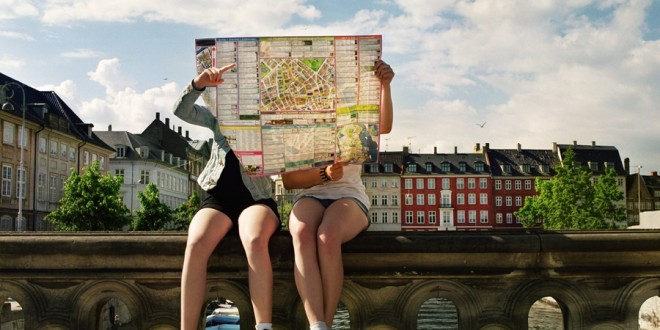 Teenager hidden by city map